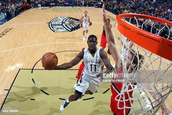 Jrue Holiday of the New Orleans Pelicans shoots against the Portland Trail Blazers on December 30 2013 at the New Orleans Arena in New Orleans...