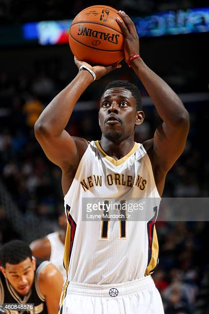 Jrue Holiday of the New Orleans Pelicans shoots against the San Antonio Spurs on December 26 2014 at Smoothie King Center in New Orleans Louisiana...