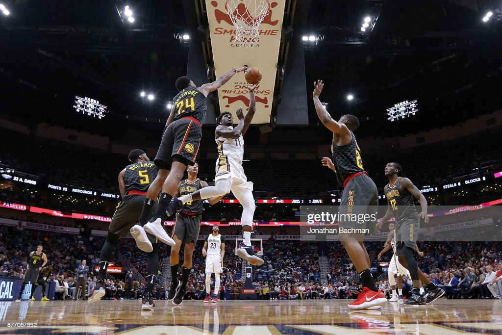 Jrue Holiday #11 of the New Orleans Pelicans shoots as Kent Bazemore #24 of the Atlanta Hawks defends during the second half of a game at the Smoothie King Center on November 13, 2017 in New Orleans, Louisiana.