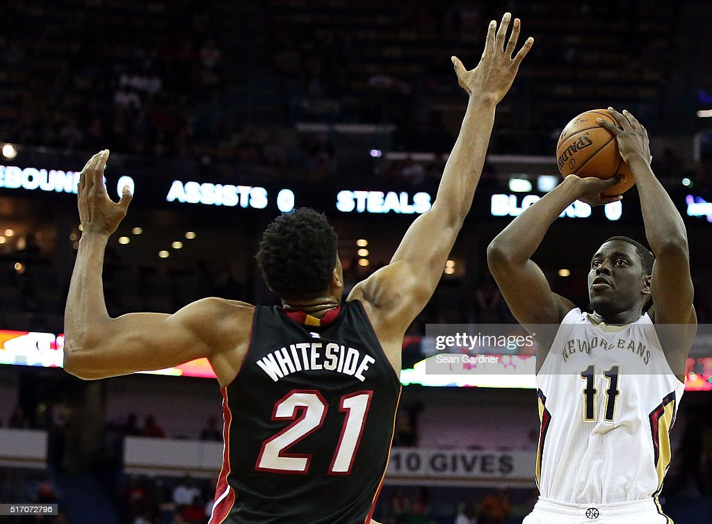 Jrue Holiday of the New Orleans Pelicans shoots over Hassan Whiteside of the Miami Heat during the first half at the Smoothie King Center on March 22...