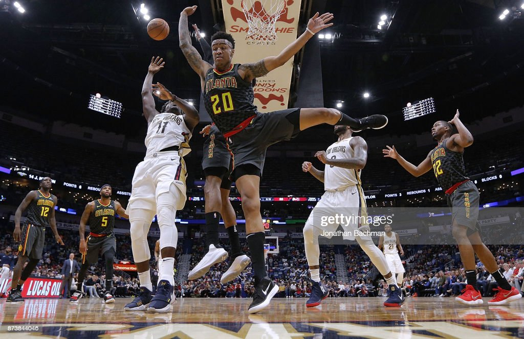 Jrue Holiday #11 of the New Orleans Pelicans shoots the ball as John Collins #20 of the Atlanta Hawks defends during the second half of a game at the Smoothie King Center on November 13, 2017 in New Orleans, Louisiana.