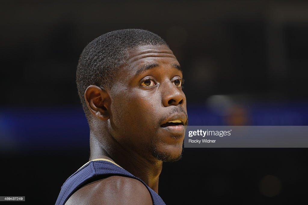 Jrue Holiday of the New Orleans Pelicans while facing the Golden State Warriors on December 17 2013 at Oracle Arena in Oakland California NOTE TO...