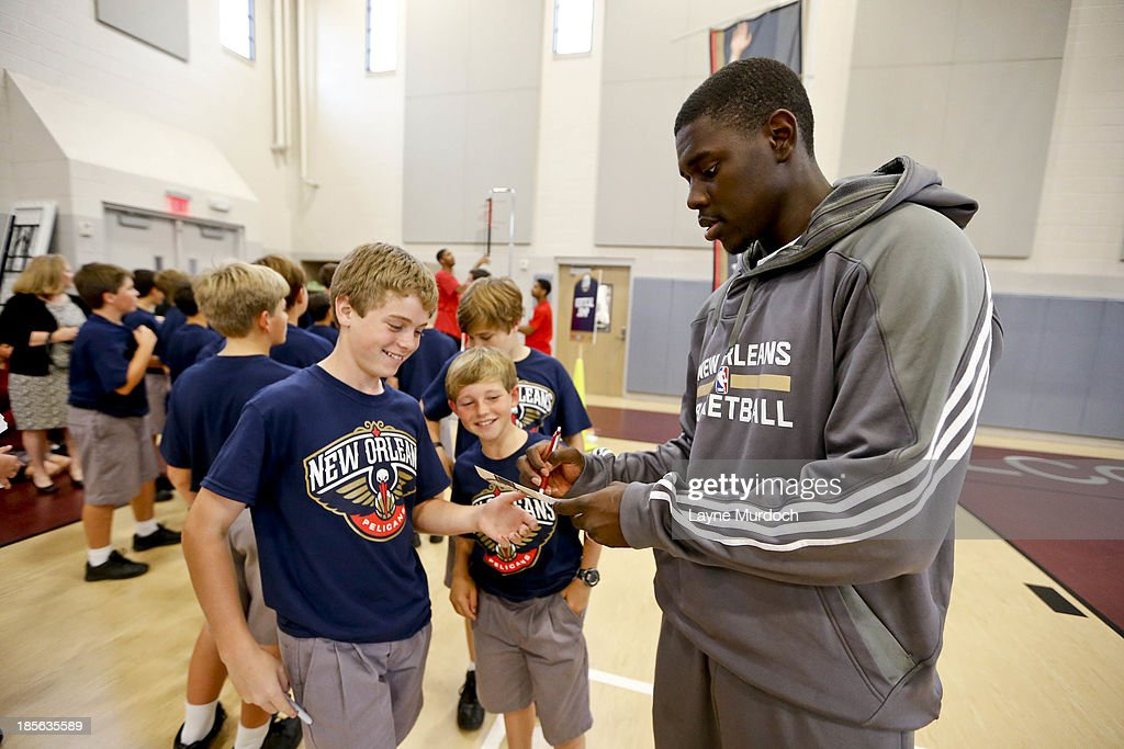 Jrue Holiday of the New Orleans Pelicans works with students as the team partnered with Ochsner Health System, Blue Cross Blue Shield of Louisiana and the Louisiana Campaign for Tobacco-Free Living (TFL) celebrate the launch of the Pelicans Junior Training Camp program on October 21, 2013 at Christian Brothers School in New Orleans, Louisiana.