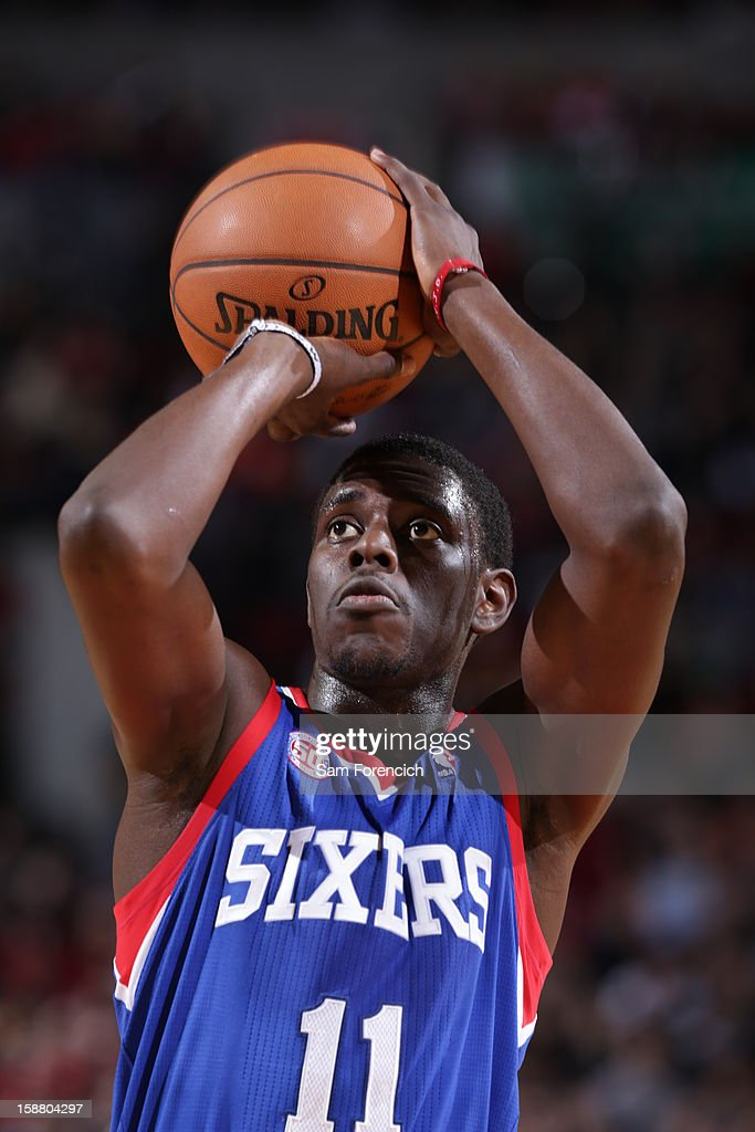 Jrue Holiday #11 of the Philadelphia 76ers aims for a free throw during the game between the Philadelphia 76ers and the Portland Trail Blazers on December 29, 2012 at the Rose Garden Arena in Portland, Oregon.