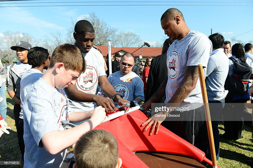 Jrue Holiday #11 of the Philadelphia 76ers and Carmelo Anthony #7 of the New York Knick work together at the 2013 NBA Cares Day of Service at the Playground Build with KaBOOM! on February 15, 2013 in Houston, Texas.