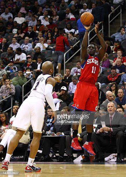 Jrue Holiday of the Philadelphia 76ers attempts a shot against Sundiata Gaines of the New Jersey Nets at Prudential Center on April 23 2012 in Newark...