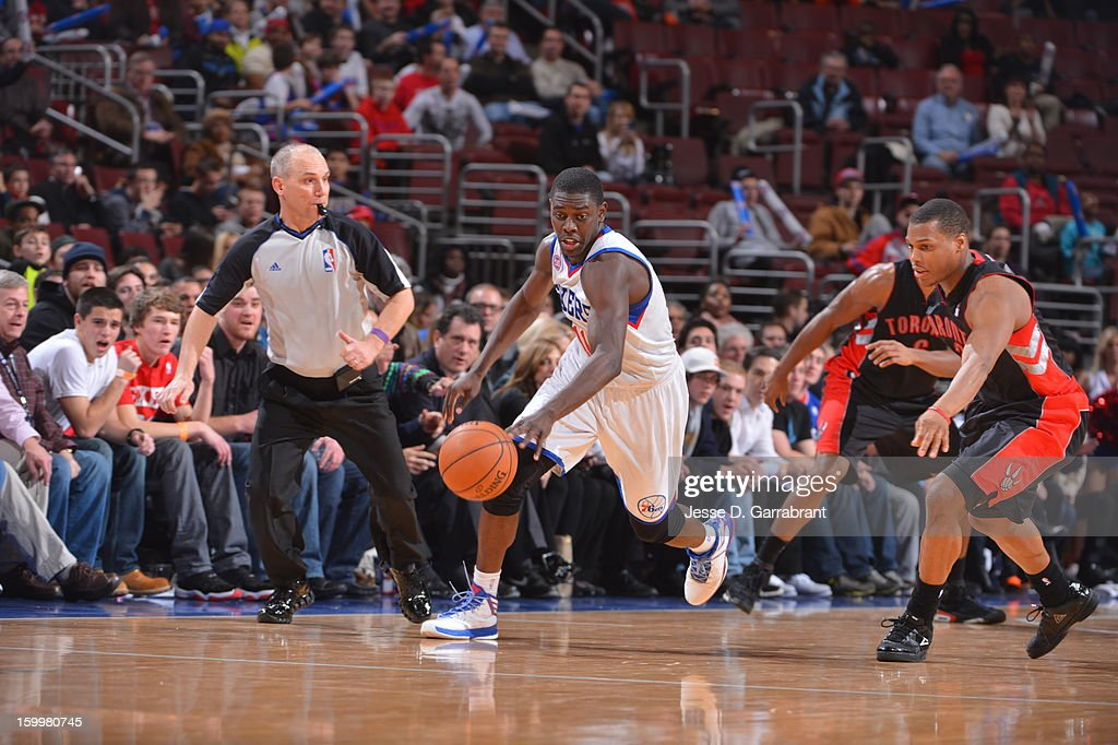 <a gi-track='captionPersonalityLinkClicked' href=/galleries/search?phrase=Jrue+Holiday&family=editorial&specificpeople=5042484 ng-click='$event.stopPropagation()'>Jrue Holiday</a> #11 of the Philadelphia 76ers brings the ball up court against the Toronto Raptors at the Wells Fargo Center on January 18, 2013 in Philadelphia, Pennsylvania.