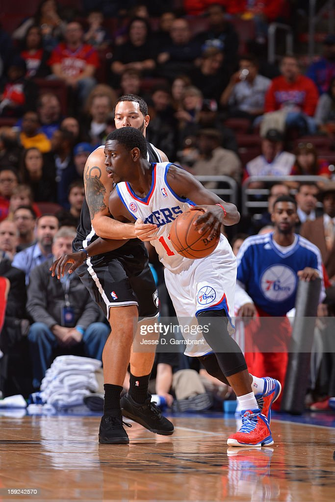 Jrue Holiday #11 of the Philadelphia 76ers dribbles the ball against the Brooklyn Nets during the game at the Wells Fargo Center on January 8, 2013 in Philadelphia, Pennsylvania.