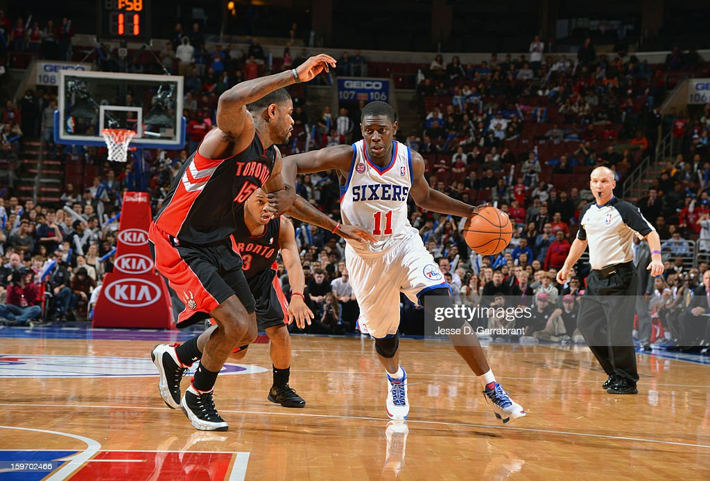Jrue Holiday #11 of the Philadelphia 76ers dribbles to the basket against Amir Johnson #15 of the Toronto Raptors during the game at the Wells Fargo Center on January 18, 2013 in Philadelphia, Pennsylvania.