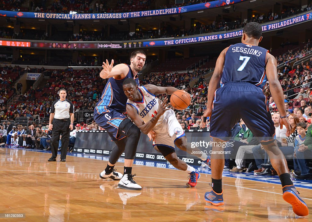Jrue Holiday #11 of the Philadelphia 76ers dribbles to the basket against Byron Mullens #22 of the Charlotte Bobcats during the game at the Wells Fargo Center on February 9, 2013 in Philadelphia, Pennsylvania.