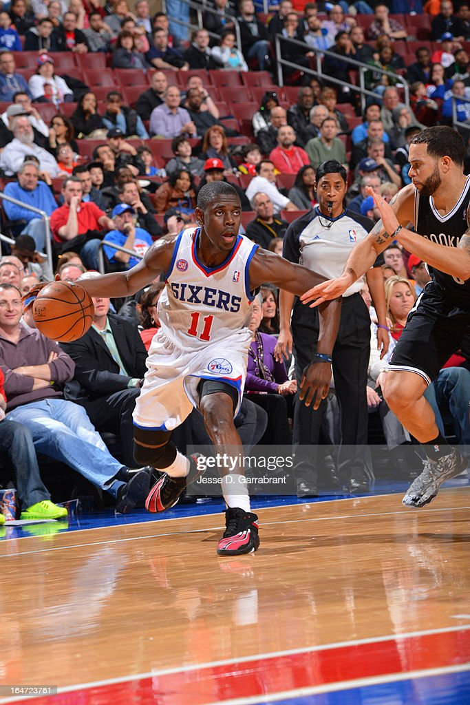 <a gi-track='captionPersonalityLinkClicked' href=/galleries/search?phrase=Jrue+Holiday&family=editorial&specificpeople=5042484 ng-click='$event.stopPropagation()'>Jrue Holiday</a> #11 of the Philadelphia 76ers drives against <a gi-track='captionPersonalityLinkClicked' href=/galleries/search?phrase=Deron+Williams&family=editorial&specificpeople=203215 ng-click='$event.stopPropagation()'>Deron Williams</a> #8 of the Brooklyn Nets at the Wells Fargo Center on March 11, 2013 in Philadelphia, Pennsylvania.