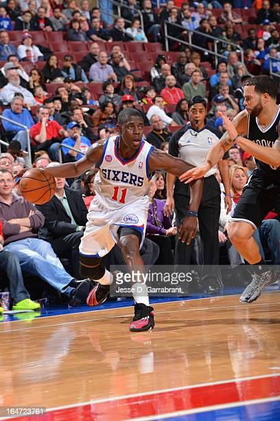 Jrue Holiday of the Philadelphia 76ers drives against Deron Williams of the Brooklyn Nets at the Wells Fargo Center on March 11 2013 in Philadelphia...
