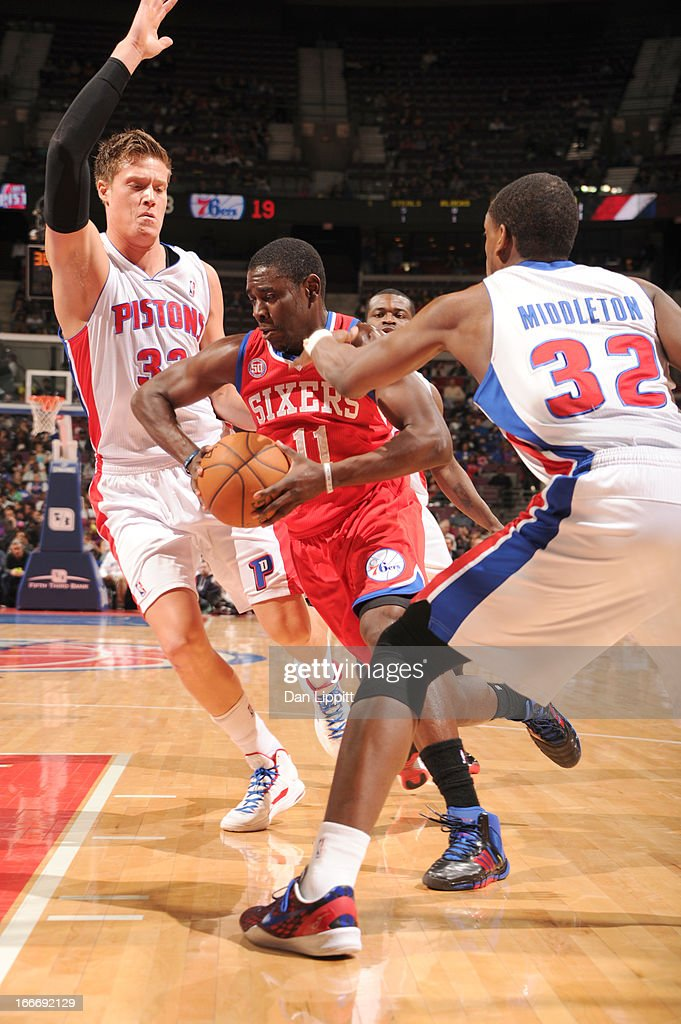 <a gi-track='captionPersonalityLinkClicked' href=/galleries/search?phrase=Jrue+Holiday&family=editorial&specificpeople=5042484 ng-click='$event.stopPropagation()'>Jrue Holiday</a> #11 of the Philadelphia 76ers drives against <a gi-track='captionPersonalityLinkClicked' href=/galleries/search?phrase=Jonas+Jerebko&family=editorial&specificpeople=5942357 ng-click='$event.stopPropagation()'>Jonas Jerebko</a> #33 of the Detroit Pistons and <a gi-track='captionPersonalityLinkClicked' href=/galleries/search?phrase=Khris+Middleton&family=editorial&specificpeople=6689629 ng-click='$event.stopPropagation()'>Khris Middleton</a> #32 of the Detroit Pistons during the game between the Detroit Pistons and the Philadelphia 76ers on April 15, 2013 at The Palace of Auburn Hills in Auburn Hills, Michigan.