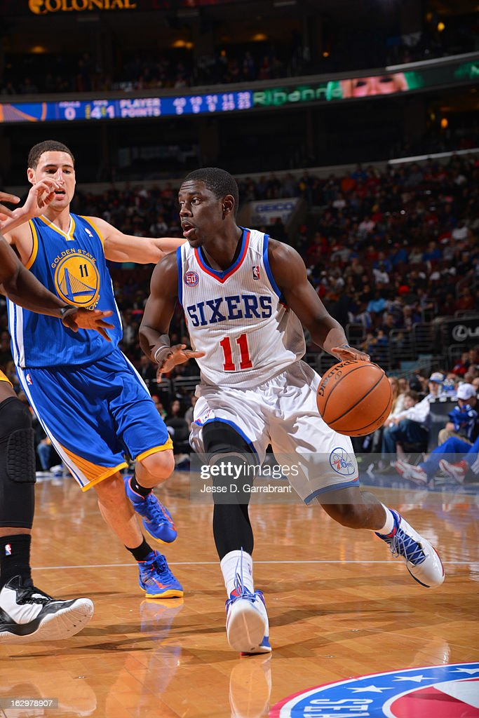 Jrue Holiday #11 of the Philadelphia 76ers drives against Klay Thompson #11 of the Golden State Warriors on March 2, 2013 at the Wells Fargo Center in Philadelphia, Pennsylvania.