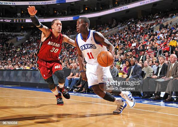 Jrue Holiday of the Philadelphia 76ers drives the ball against Michael Beasley of the Miami Heat during the game on February 16 2010 at the Wachovia...
