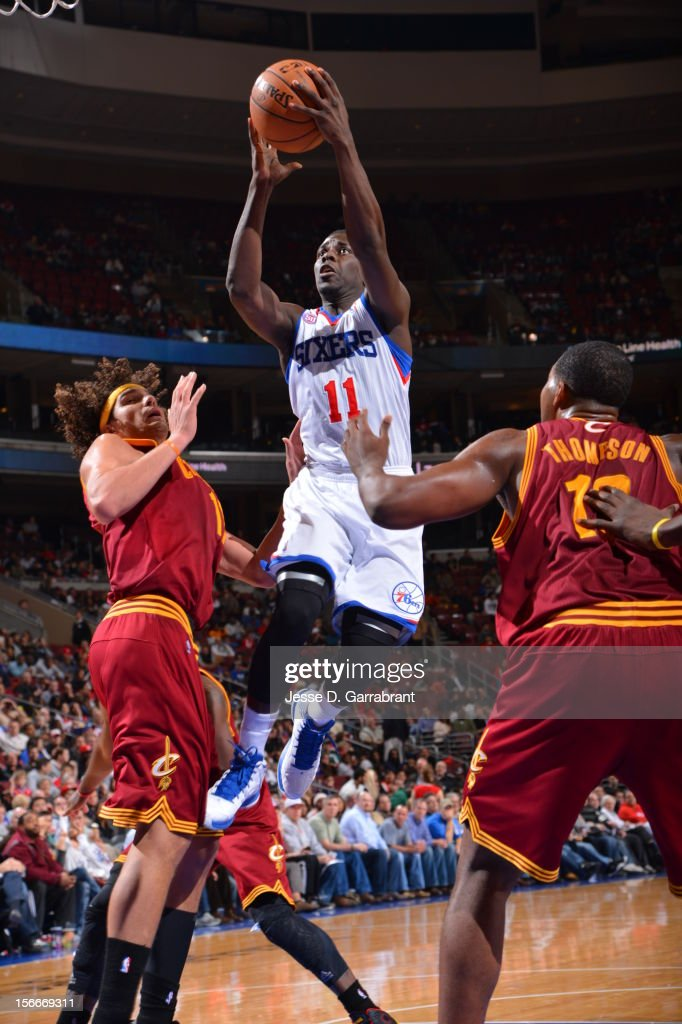 Jrue Holiday #11 of the Philadelphia 76ers drives to the basket against Anderson Varejao #17 of the Cleveland Cavaliers at the Wells Fargo Center on November 18, 2012 in Philadelphia, Pennsylvania.
