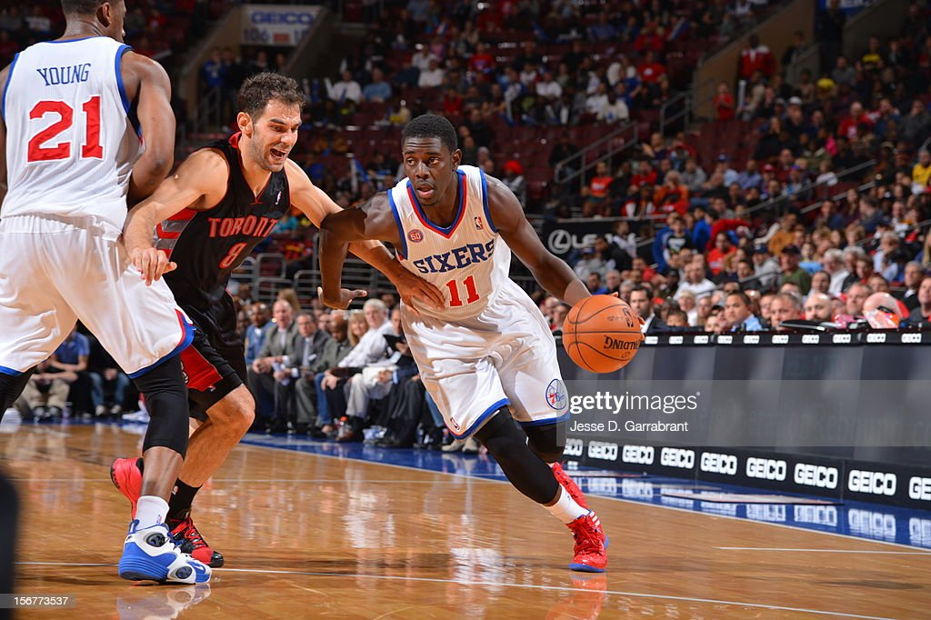 Jrue Holiday #11 of the Philadelphia 76ers drives to the basket against Jose Calderon #8 of the Toronto Raptors at the Wells Fargo Center on November 20, 2012 in Philadelphia, Pennsylvania.