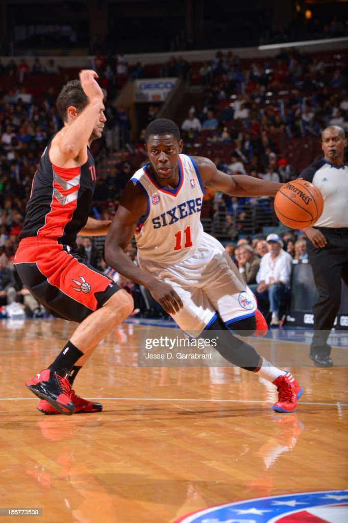 Jrue Holiday #11 of the Philadelphia 76ers drives to the basket against Jose Calderon #8 of the Toronto Raptors during the game at the Wells Fargo Center on November 20, 2012 in Philadelphia, Pennsylvania.