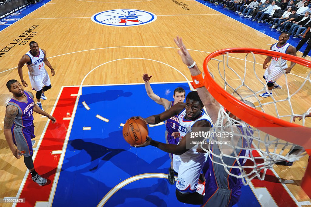 Jrue Holiday #11 of the Philadelphia 76ers drives to the basket against the Phoenix Suns at the Wells Fargo Center on November 25, 2012 in Philadelphia, Pennsylvania.