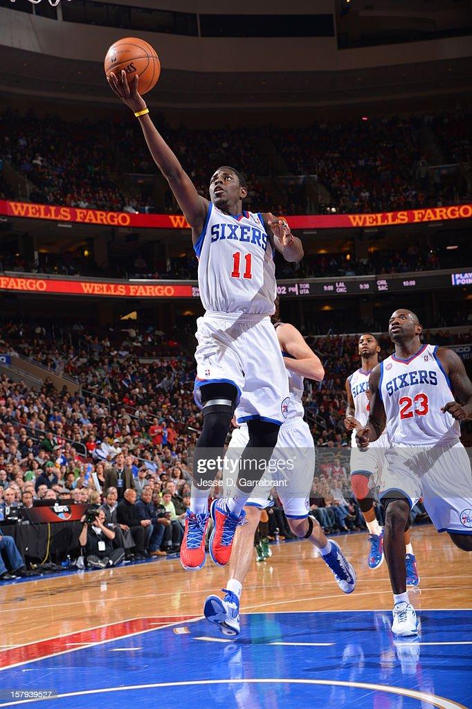 Jrue Holiday #11 of the Philadelphia 76ers drives to the basket against the Boston Celtics at the Wells Fargo Center on December 7, 2012 in Philadelphia, Pennsylvania.