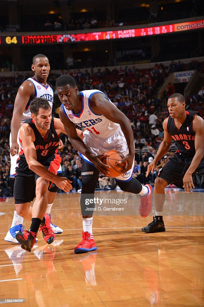 <a gi-track='captionPersonalityLinkClicked' href=/galleries/search?phrase=Jrue+Holiday&family=editorial&specificpeople=5042484 ng-click='$event.stopPropagation()'>Jrue Holiday</a> #11 of the Philadelphia 76ers drives to the basket against the Toronto Raptors at the Wells Fargo Center on November 20, 2012 in Philadelphia, Pennsylvania.