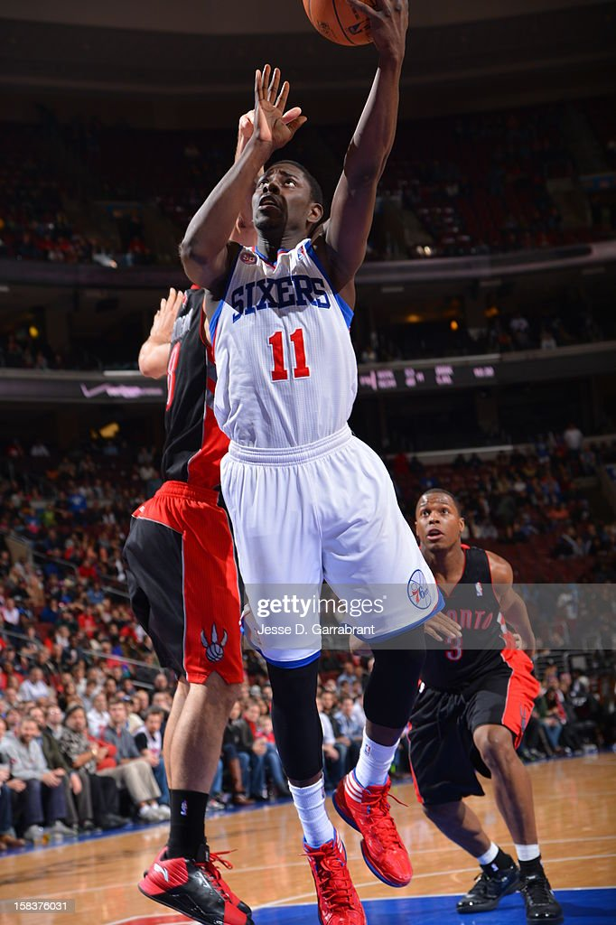 Jrue Holiday #11 of the Philadelphia 76ers drives to the basket against the Toronto Raptors at the Wells Fargo Center on November 20, 2012 in Philadelphia, Pennsylvania.