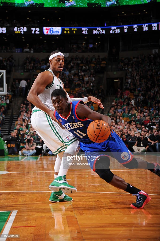Jrue Holiday #11 of the Philadelphia 76ers drives to the basket against Paul Pierce #34 of the Boston Celtics on December 8, 2012 at the TD Garden in Boston, Massachusetts.