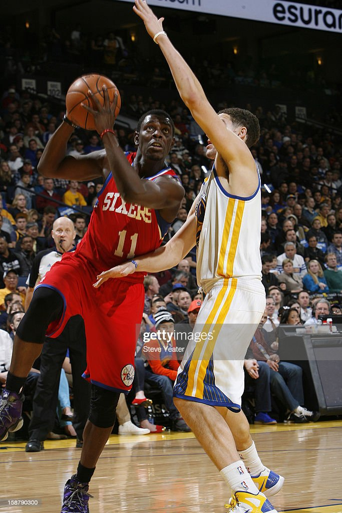 Jrue Holiday #11 of the Philadelphia 76ers drives to the basket against Klay Thompson #11 of the Golden State Warriors on December 28, 2012 at Oracle Arena in Oakland, California.