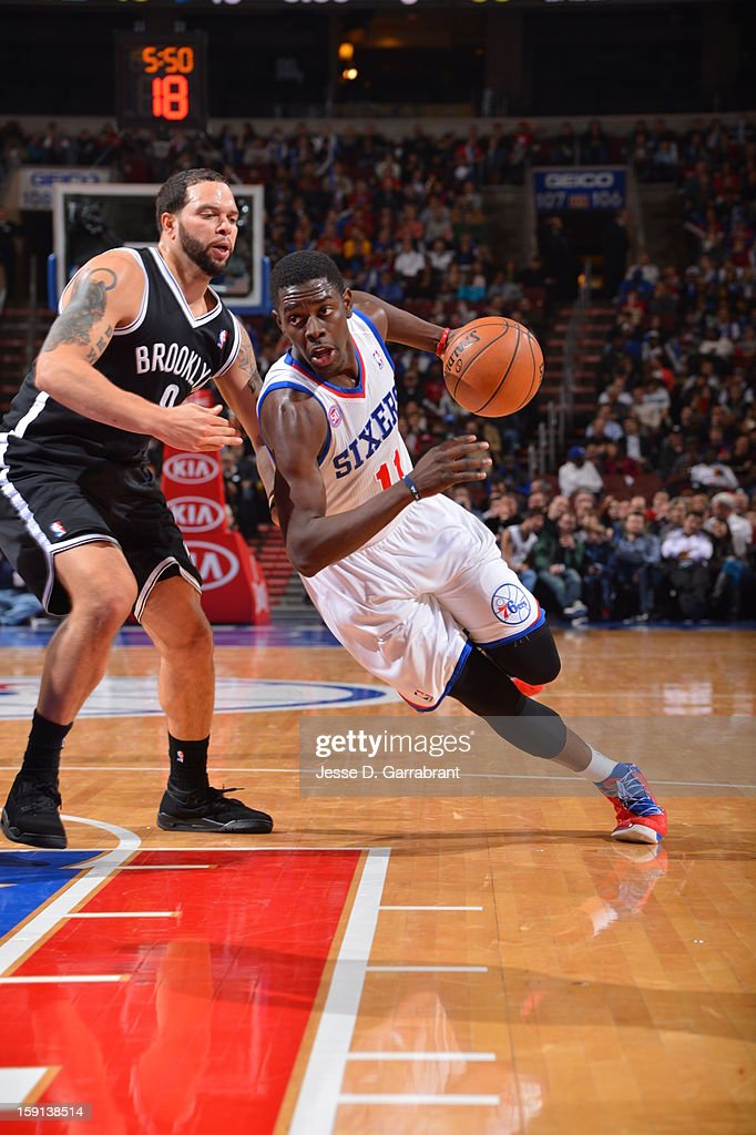<a gi-track='captionPersonalityLinkClicked' href=/galleries/search?phrase=Jrue+Holiday&family=editorial&specificpeople=5042484 ng-click='$event.stopPropagation()'>Jrue Holiday</a> #11 of the Philadelphia 76ers drives to the basket against <a gi-track='captionPersonalityLinkClicked' href=/galleries/search?phrase=Deron+Williams&family=editorial&specificpeople=203215 ng-click='$event.stopPropagation()'>Deron Williams</a> #8 of the Brooklyn Nets during the game at the Wells Fargo Center on January 8, 2013 in Philadelphia, Pennsylvania.