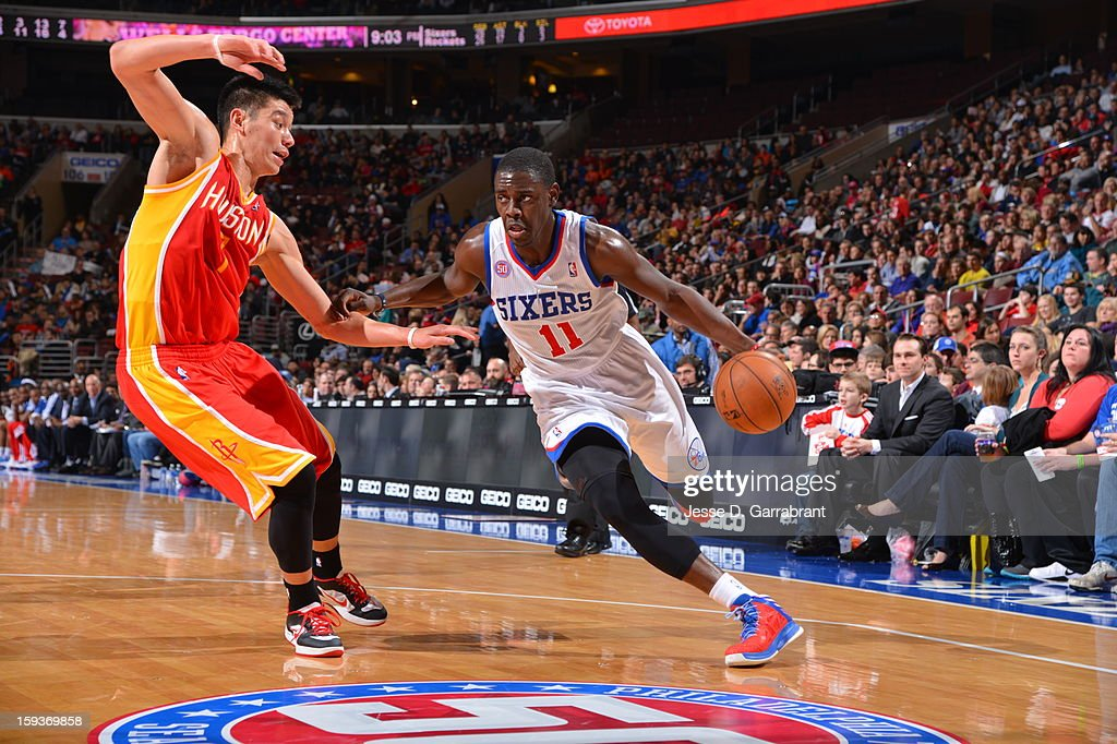 Jrue Holiday #11 of the Philadelphia 76ers drives to the basket against Jeremy Lin #7 of the Houston Rockets during the game at the Wells Fargo Center on January 12, 2013 in Philadelphia, Pennsylvania.