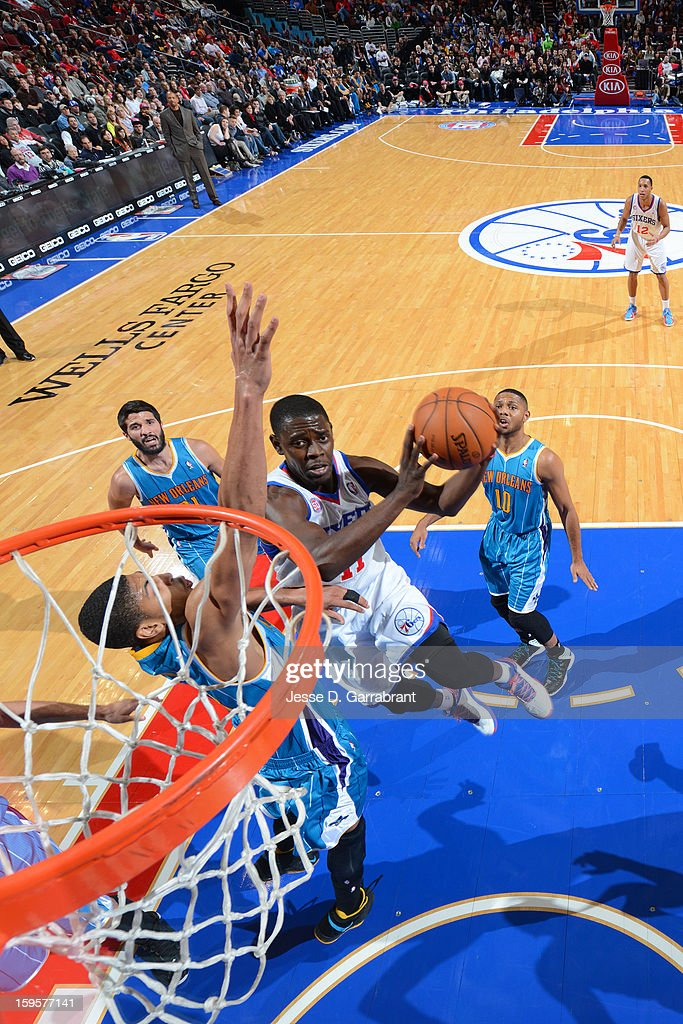 Jrue Holiday #11 of the Philadelphia 76ers drives to the basket against the Philadelphia 76ers at the Wells Fargo Center on January 15, 2013 in Philadelphia, Pennsylvania.