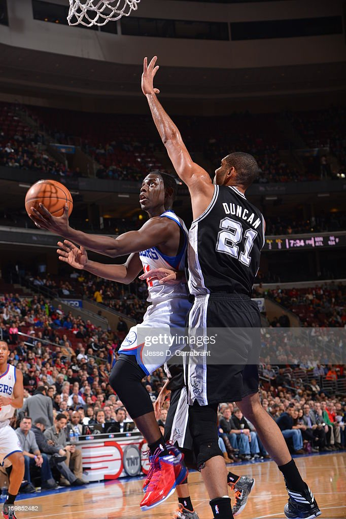 Jrue Holiday #11 of the Philadelphia 76ers drives to the basket against Tim Duncan #21 of the San Antonio Spurs during the game at the Wells Fargo Center on January 21, 2013 in Philadelphia, Pennsylvania.