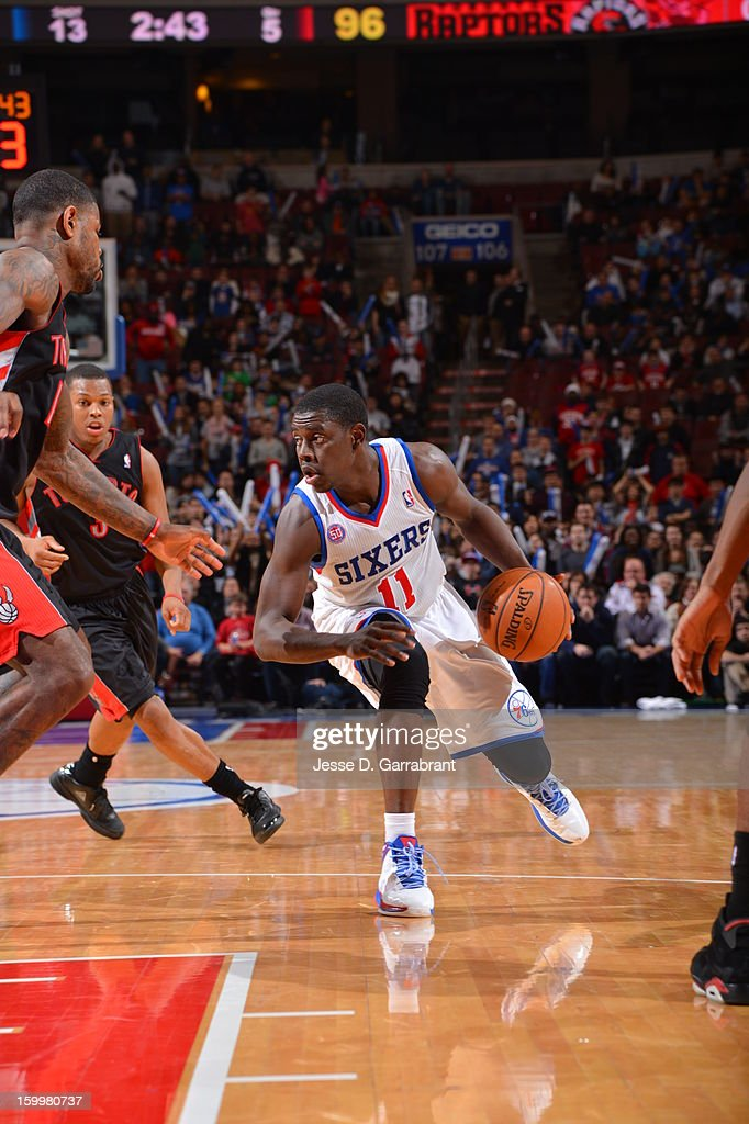 <a gi-track='captionPersonalityLinkClicked' href=/galleries/search?phrase=Jrue+Holiday&family=editorial&specificpeople=5042484 ng-click='$event.stopPropagation()'>Jrue Holiday</a> #11 of the Philadelphia 76ers drives to the basket against the Toronto Raptors at the Wells Fargo Center on January 18, 2013 in Philadelphia, Pennsylvania.