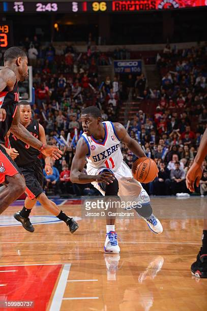 Jrue Holiday of the Philadelphia 76ers drives to the basket against the Toronto Raptors at the Wells Fargo Center on January 18 2013 in Philadelphia...