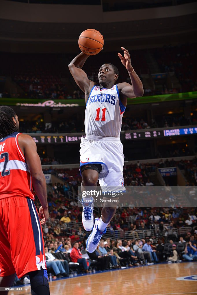 <a gi-track='captionPersonalityLinkClicked' href=/galleries/search?phrase=Jrue+Holiday&family=editorial&specificpeople=5042484 ng-click='$event.stopPropagation()'>Jrue Holiday</a> #11 of the Philadelphia 76ers drives to the basket against the Washington Wizards at the Wells Fargo Center on January 30, 2013 in Philadelphia, Pennsylvania.