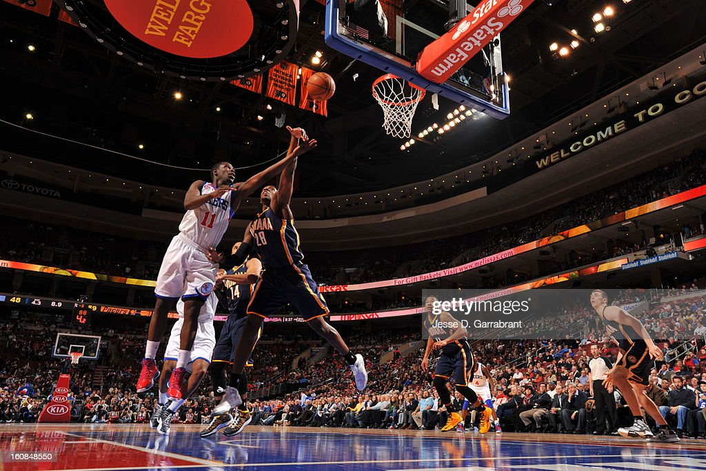 <a gi-track='captionPersonalityLinkClicked' href=/galleries/search?phrase=Jrue+Holiday&family=editorial&specificpeople=5042484 ng-click='$event.stopPropagation()'>Jrue Holiday</a> #11 of the Philadelphia 76ers drives to the basket against <a gi-track='captionPersonalityLinkClicked' href=/galleries/search?phrase=Ian+Mahinmi&family=editorial&specificpeople=740196 ng-click='$event.stopPropagation()'>Ian Mahinmi</a> #28 of the Indiana Pacers during the game at the Wells Fargo Center on February 6, 2013 in Philadelphia, Pennsylvania.