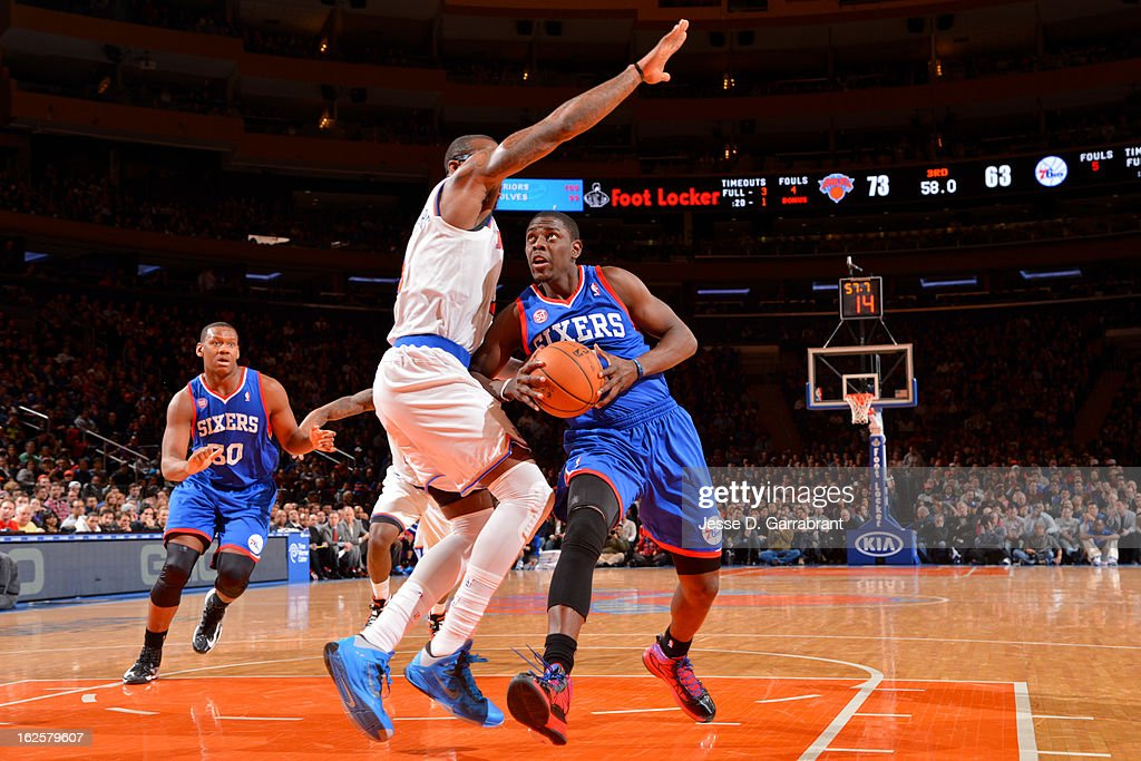 Jrue Holiday #11 of the Philadelphia 76ers drives to the basket against Amar'e Stoudemire #1 of the New York Knicks on February 24, 2013 at Madison Square Garden in New York City, New York.