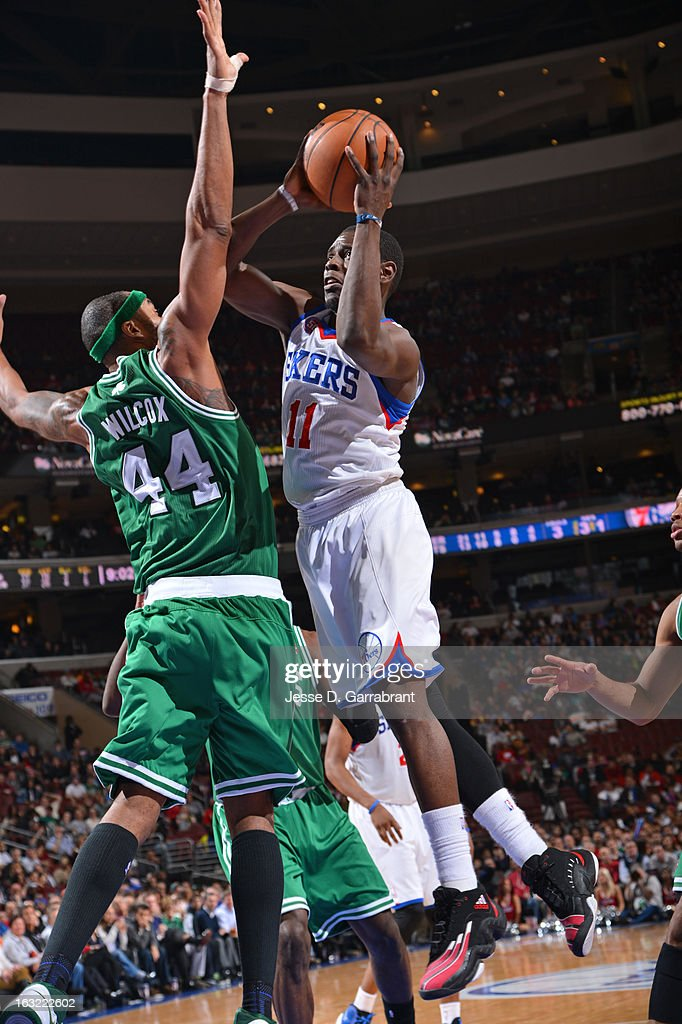 Jrue Holiday #11 of the Philadelphia 76ers drives to the basket against the Boston Celtics on March 5, 2013 at the Wells Fargo Center in Philadelphia, Pennsylvania.
