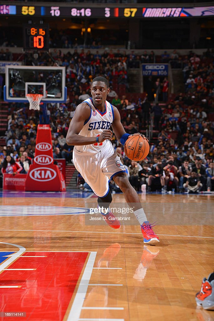 Jrue Holiday #11 of the Philadelphia 76ers drives to the basket against the Charlotte Bobcats at the Wells Fargo Center on March 30, 2013 in Philadelphia, Pennsylvania.