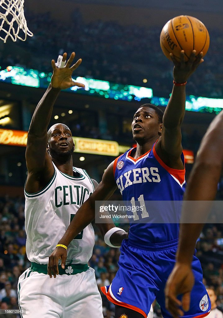 Jrue Holiday #11 of the Philadelphia 76ers drives to the basket for a layup in front of Kevin Garnett #5 of the Boston Celtics during the game on December 8, 2012 at TD Garden in Boston, Massachusetts.