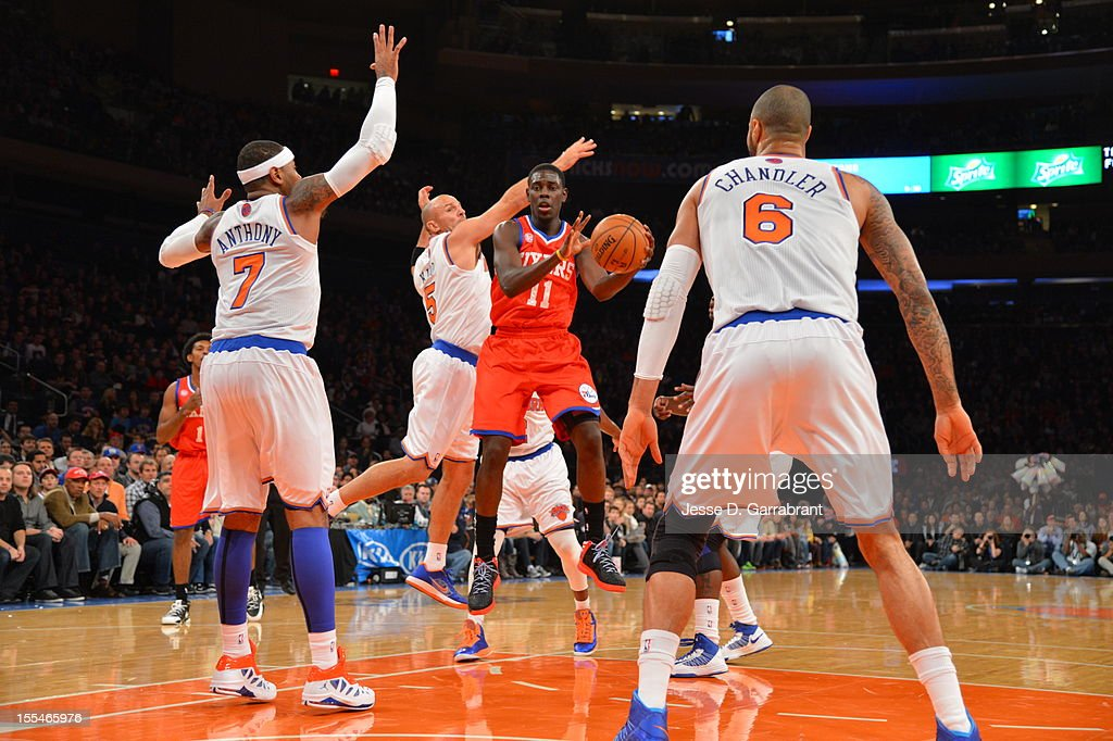Jrue Holiday #11 of the Philadelphia 76ers drives to the basket vs Carmelo Anthony #7 of the New York Knicks on November 4, 2012 at Madison Square Garden in New York City.