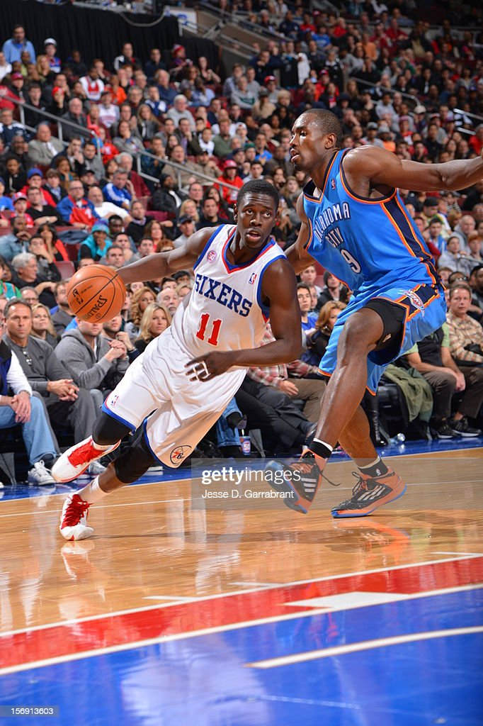 Jrue Holiday #11 of the Philadelphia 76ers drives to the hoop vs the Oklahoma City Thunder at the Wells Fargo Center on November 24, 2012 in Philadelphia, Pennsylvania.