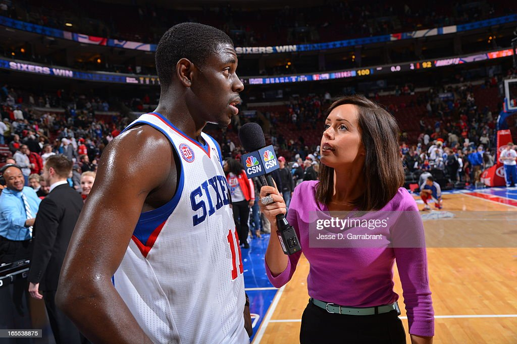 Jrue Holiday #11 of the Philadelphia 76ers gets interviewed after the game against the Charlotte Bobcats at the Wells Fargo Center on March 30, 2013 in Philadelphia, Pennsylvania.