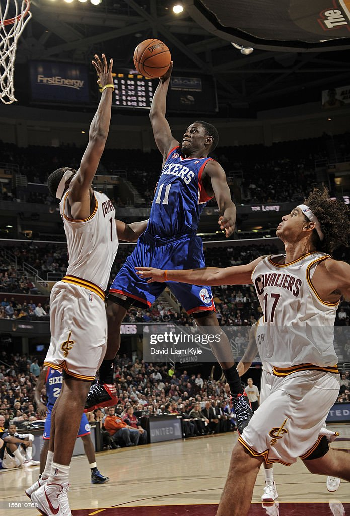 <a gi-track='captionPersonalityLinkClicked' href=/galleries/search?phrase=Jrue+Holiday&family=editorial&specificpeople=5042484 ng-click='$event.stopPropagation()'>Jrue Holiday</a> #11 of the Philadelphia 76ers goes in for the dunk against <a gi-track='captionPersonalityLinkClicked' href=/galleries/search?phrase=Tristan+Thompson&family=editorial&specificpeople=5799092 ng-click='$event.stopPropagation()'>Tristan Thompson</a> #13 of the Cleveland Cavaliers at The Quicken Loans Arena on November 21, 2012 in Cleveland, Ohio.