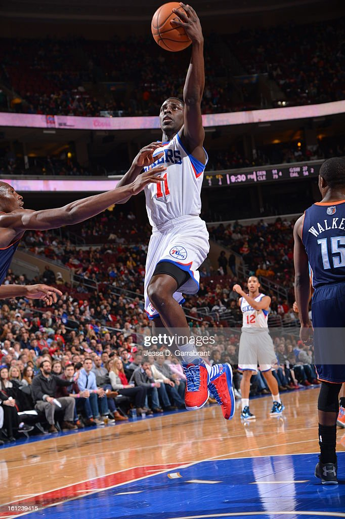 Jrue Holiday #11 of the Philadelphia 76ers goes to the basket against the Charlotte Bobcats during the game at the Wells Fargo Center on February 9, 2013 in Philadelphia, Pennsylvania.