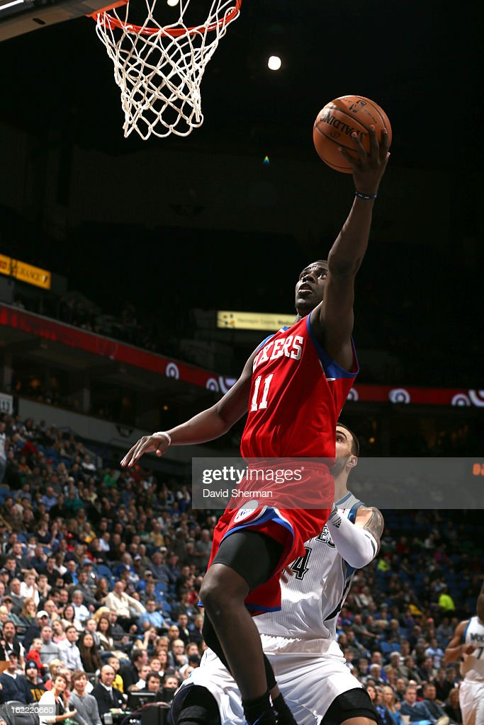 Jrue Holiday #11 of the Philadelphia 76ers goes to the basket during the game between Philadelphia 76ers and the Minnesota Timberwolves on February 20, 2013 at Target Center in Minneapolis, Minnesota.