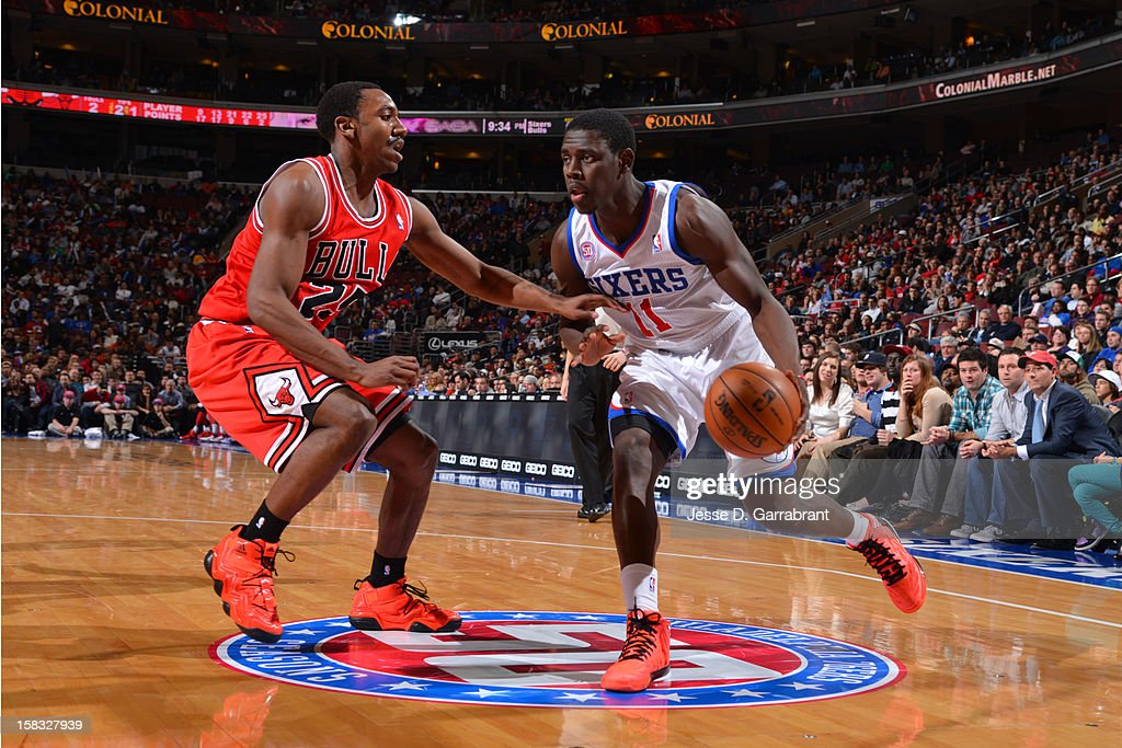 <a gi-track='captionPersonalityLinkClicked' href=/galleries/search?phrase=Jrue+Holiday&family=editorial&specificpeople=5042484 ng-click='$event.stopPropagation()'>Jrue Holiday</a> #11 of the Philadelphia 76ers handles the ball against <a gi-track='captionPersonalityLinkClicked' href=/galleries/search?phrase=Marquis+Teague&family=editorial&specificpeople=7621183 ng-click='$event.stopPropagation()'>Marquis Teague</a> #25 of the Chicago Bulls on December 12, 2012 at the Wells Fargo Center in Philadelphia, Pennsylvania.