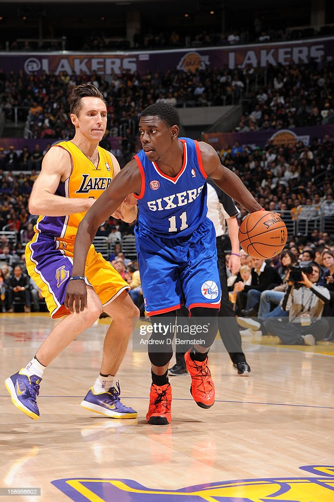 <a gi-track='captionPersonalityLinkClicked' href=/galleries/search?phrase=Jrue+Holiday&family=editorial&specificpeople=5042484 ng-click='$event.stopPropagation()'>Jrue Holiday</a> #11 of the Philadelphia 76ers handles the ball against <a gi-track='captionPersonalityLinkClicked' href=/galleries/search?phrase=Steve+Nash&family=editorial&specificpeople=201513 ng-click='$event.stopPropagation()'>Steve Nash</a> #10 of the Los Angeles Lakers at Staples Center on January 1, 2013 in Los Angeles, California.