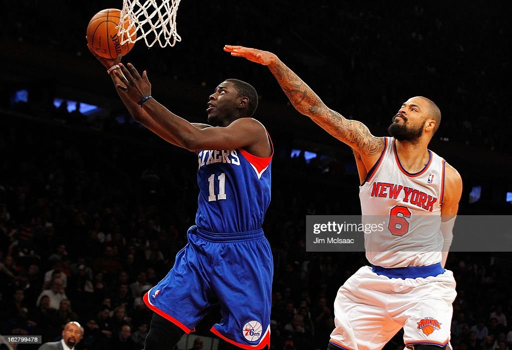 Jrue Holiday #11 of the Philadelphia 76ers in action against Tyson Chandler #6 of the New York Knicks at Madison Square Garden on February 24, 2013 in New York City. The Knicks defeated the 76ers 99-93.