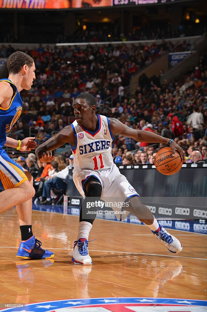 <a gi-track='captionPersonalityLinkClicked' href=/galleries/search?phrase=Jrue+Holiday&family=editorial&specificpeople=5042484 ng-click='$event.stopPropagation()'>Jrue Holiday</a> #11 of the Philadelphia 76ers looks to drive to the basket against the Golden State Warriors on March 2, 2013 at the Wells Fargo Center in Philadelphia, Pennsylvania.